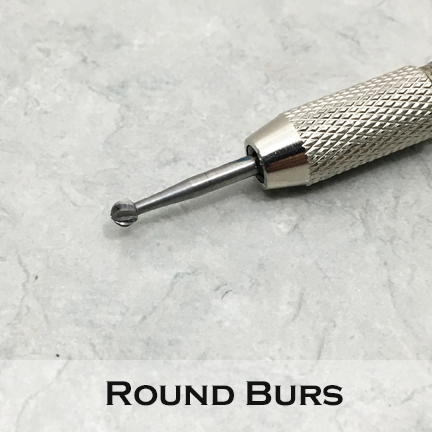 Round Bur shown mounted in a pin vise